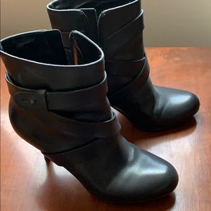 High-heel black leather ankle boots